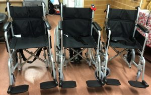 The new wheelchairs, one with a push aid have arrived
